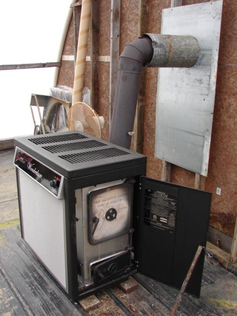 this is our woodstove in the greenhouse..it heats a 20x40 11' tall area - Lets See Your Woodburner Setup Trapper Talk Trapperman.com Forums