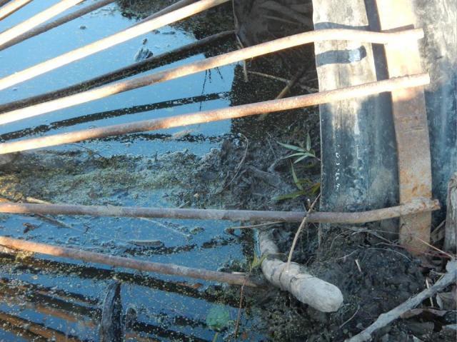 how to clean debris from an underground culvert