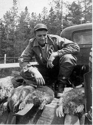 Charles Dobbins with beavers - 1950's
